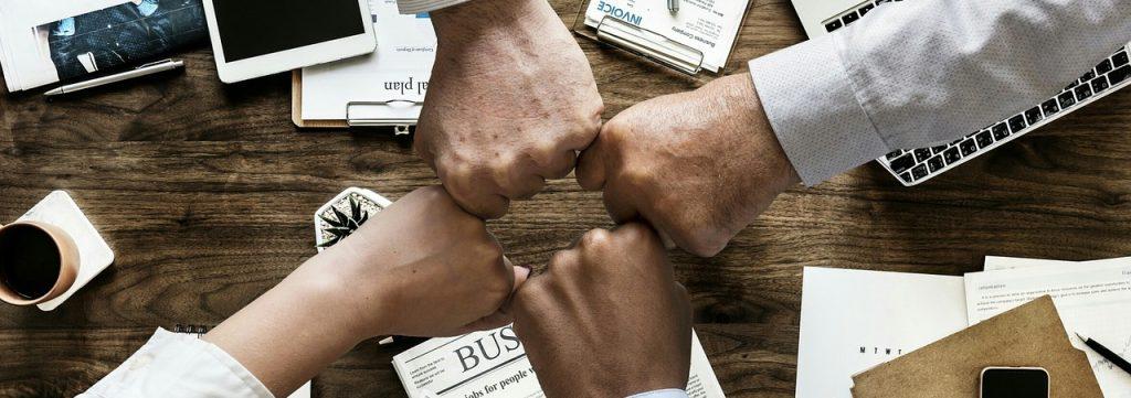 four hands fist pump